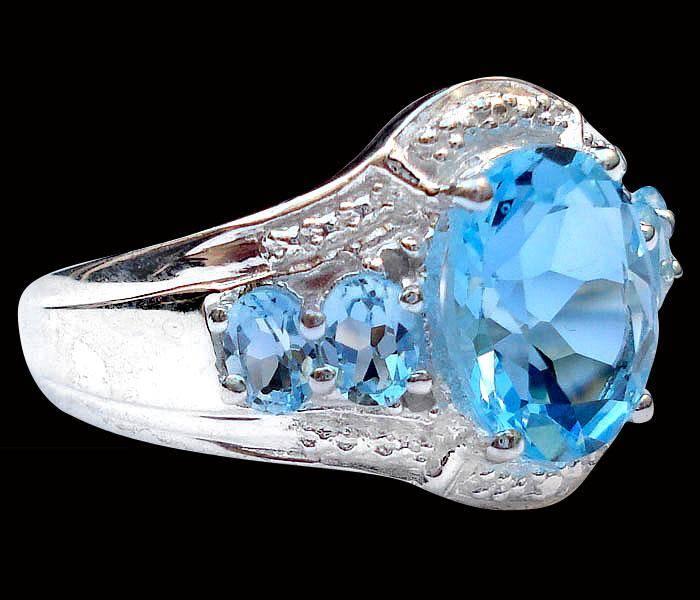 Anel de Prata 925 com Água Marinha e 0,6 Cts de Diamantes Naturais